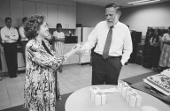 Adobe co-founder Chuck Geschke hands a gift to Linda Garger, who was the first administrative assistance for Geschke and John Warnock., Adobe co-founder Chuck Geschke hands a gift to Linda Garger, who was the first administrative assistance for Geschke and John Warnock.