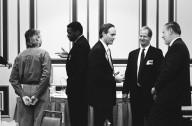 Adobe founder Chuck Geschke (far right) and Vice President Dave Pratt (next to Geschke) in a discussion with a colleague., Adobe founder Chuck Geschke (far right) and Vice President Dave Pratt (next to Geschke) in a discussion with a colleague.