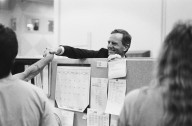 Apple CEO John Sculley shakes hands with an Apple employee., Apple CEO John Sculley shakes hands with an Apple employee.