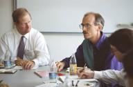 Adobe Vice President Dave Pratt (left) in a meeting with colleagues., Adobe Vice President Dave Pratt (left) in a meeting with colleagues.