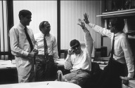 """Sun Microsystems co-founder Scott McNealy (seated) """"high fives"""" a colleague., Sun Microsystems co-founder Scott McNealy (seated) """"high fives"""" a colleague."""