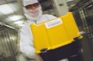 An IBM clean room technician., An IBM clean room technician.