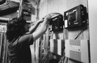 Mark Vinsel, Farallon's network manager, installs networking equipment in Farallon's new Emeryville, California, headquarters., Mark Vinsel, Farallon's network manager, installs networking equipment in Farallon's new Emeryville, California, headquarters.