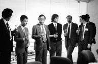 Steve Jobs (center, in sweater vest) and Canon executives shortly before the Japanese camera and office equipment manufacturer announced its plan to invest $100 million in NeXT for a 16.67 percent stake in the company., Steve Jobs (center, in sweater vest) and Canon executives shortly before the Japanese camera and office equipment manufacturer announced its plan to invest $100 million in NeXT for a 16.67 percent stake in the company.