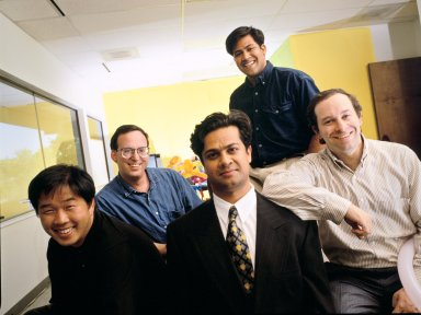 The co-founders of NetObjects (left to right in front row): Clement Mok, Samir Arora and David Kleinberg, along with Vice President of Business Development Tom Melcher (seated, second row) and Vice President of Product Development Sal Arora (standing, second row)., The co-founders of NetObjects (left to right in front row): Clement Mok, Samir Arora and David Kleinberg, along with Vice President of Business Development Tom Melcher (seated, second row) and Vice President of Product Development Sal Arora (standing, second row).
