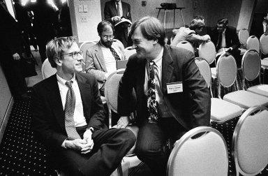 John Doerr, a Kleiner Perkins partner (left), in conversation with a colleague., John Doerr, a Kleiner Perkins partner (left), in conversation with a colleague.