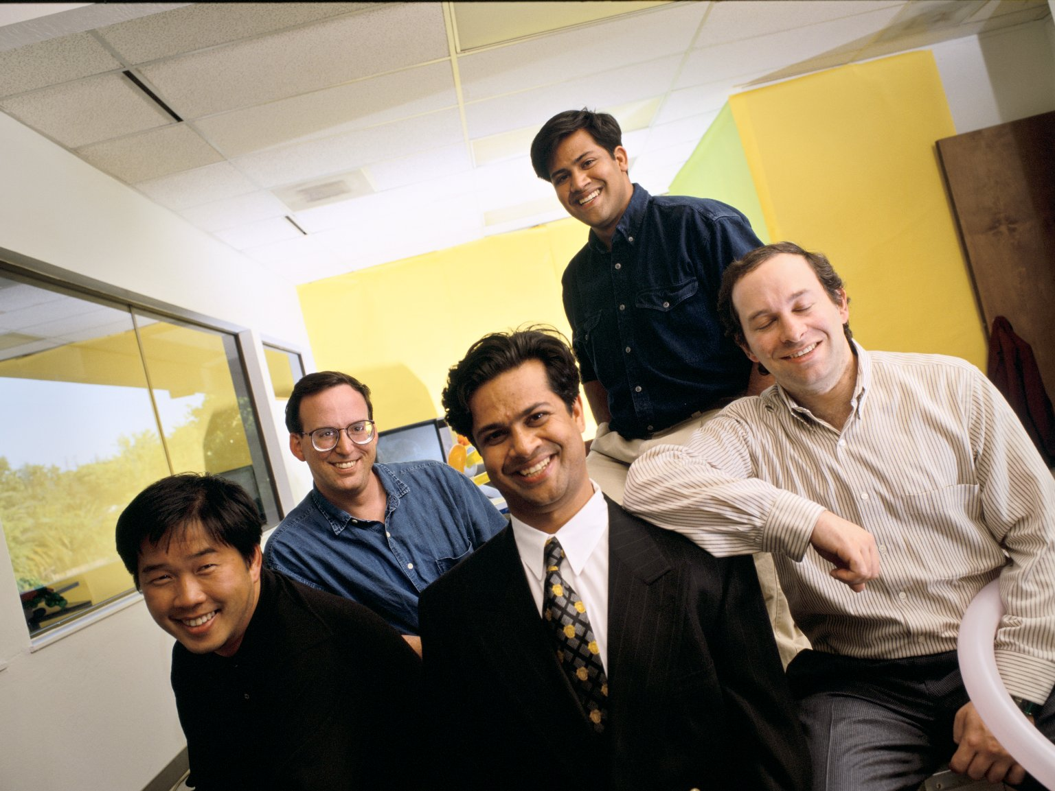 The co-founders of NetObjects (left to right in front row): Clement Mok, Samir Arora and David Kleinberg, along with Tom Melcher (seated in second row), vice president of business development, and Sal Arora (standing), vice president of product development.