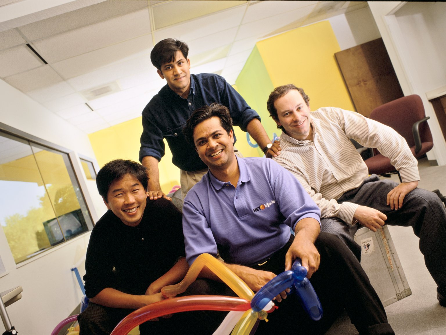 The co-founders of NetObjects (left to right): Clement Mok, Samir Arora and David Kleinberg, along with Vice President of Product Development Sal Arora (standing).